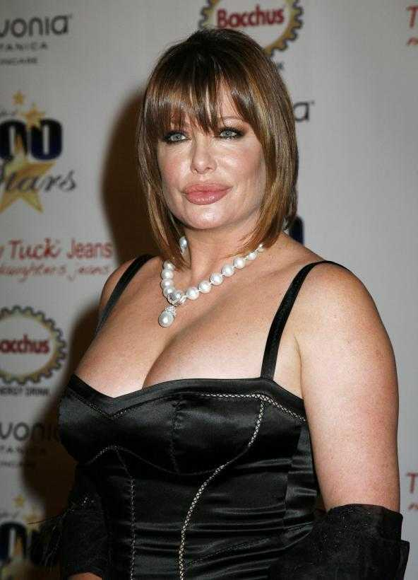 Kelly LeBrock sexy cleavage