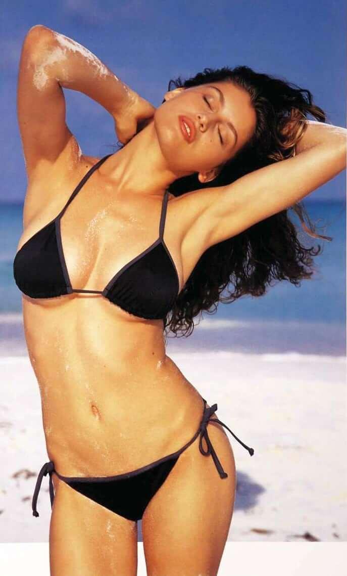 Laetitia Casta sexy black bikini pics