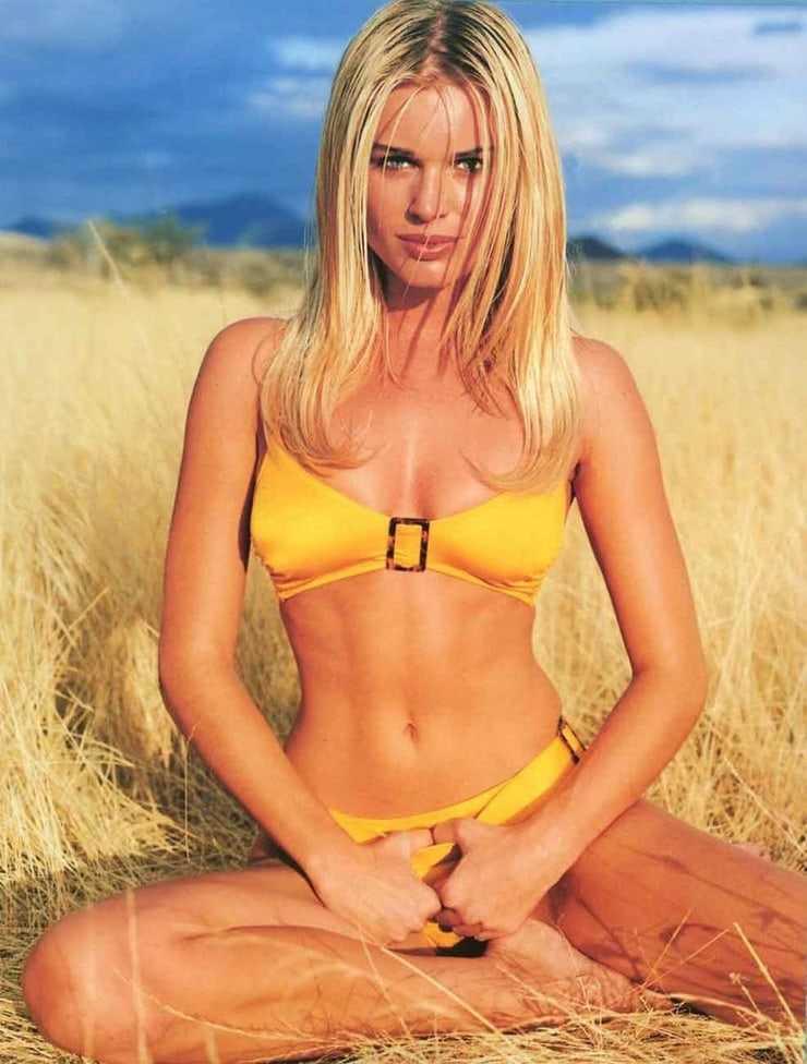 Rebecca Romijn hot yellow bikini pictures