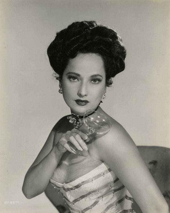 Merle Oberon sexy cleavage pics