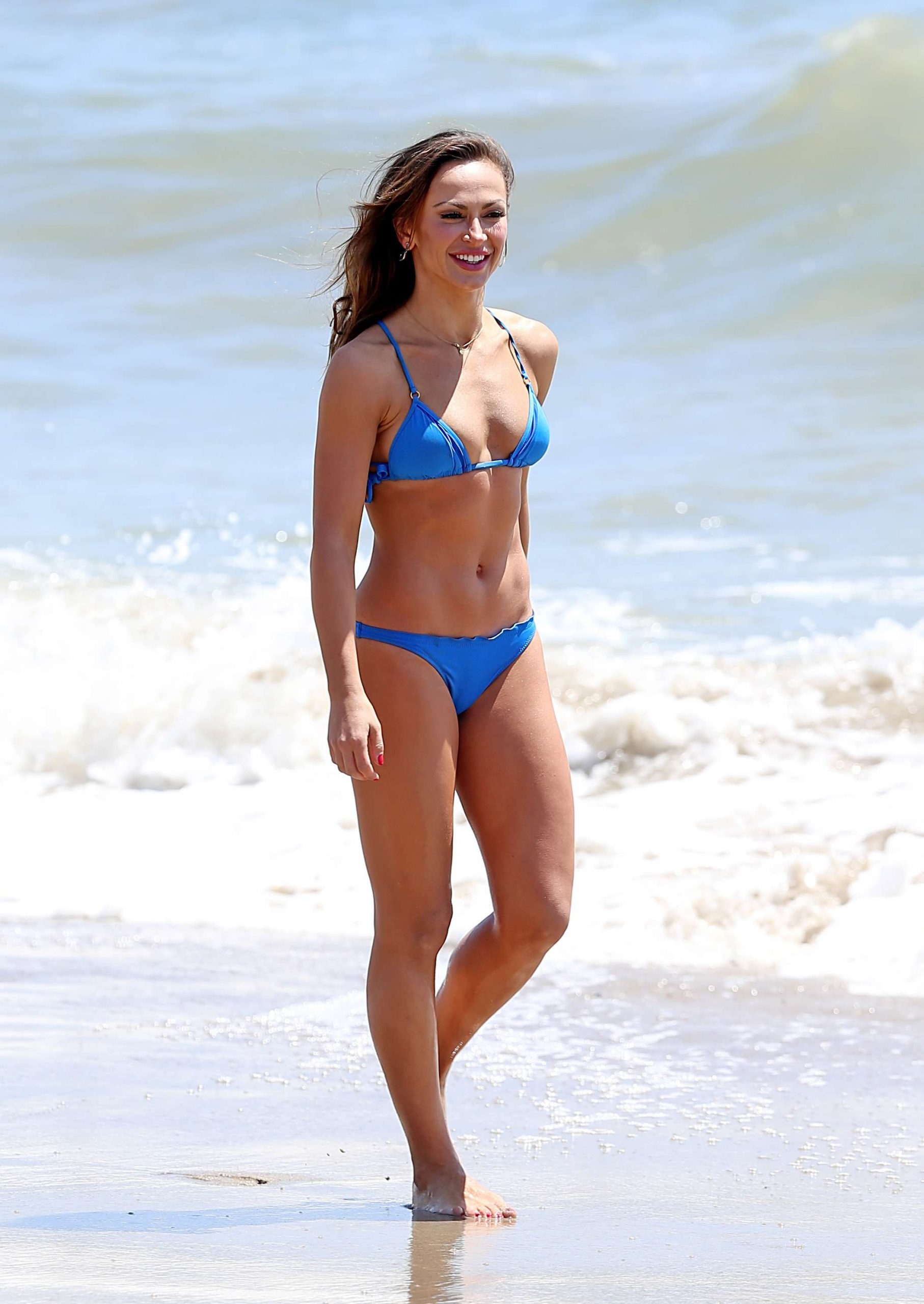 EXCLUSIVE: Karina Smirnoff looks stunning as she hits the beach showing off her bikini body.The star was spotted stepping out in the figure-hugging swimsuit in Malibu.
